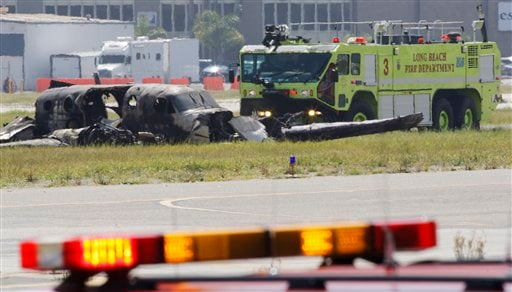 The wreckage of a twin-engine Beechcraft King Air is seen where it crashed and burned at Long Beach, Calif., Airport, Wednesday, March 16, 2011.