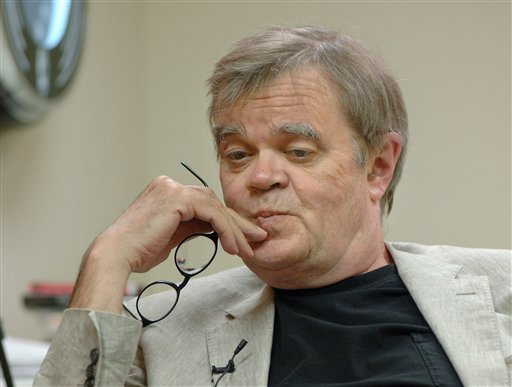 FILE - In this Sept. 16, 2009 file photo, radio show host Garrison Keillor resumes work in his Prairie Home Productions office in St. Paul, Minn.