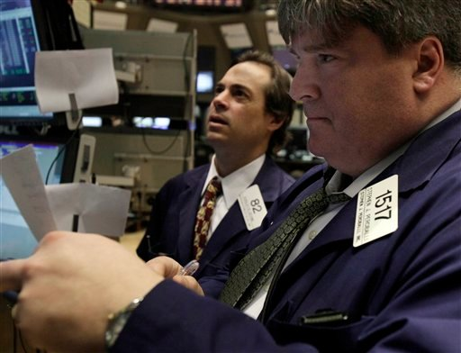 In this March 16, 2011 photo, traders work on the floor of the New York Stock Exchange.