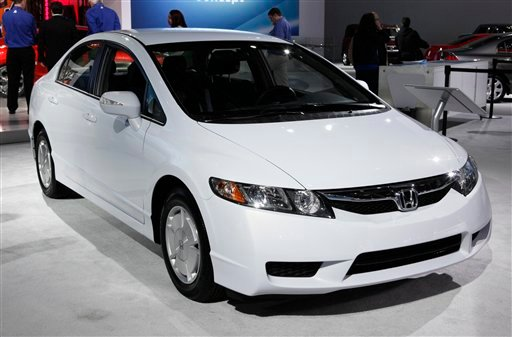 In this Jan. 12, 2011 photo, a 2011 Honda Civic Hybrid is shown at the North American International Auto Show in Detroit. Vehicles that go 40 miles on a gallon of gasoline are becoming more common, prompted by government requirements and advances in techn