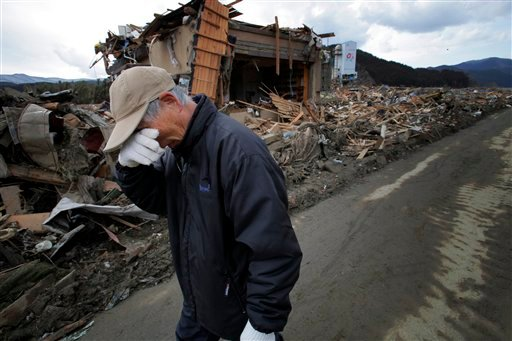 Katsuo Maiya, 73, cries in front of the rubble where his sister in row's house stood in Rikuzentakata, Iwate Prefecture, northern Japan, Thursday, March 17, 2011. Maiya's sister in row and her husband were killed in Friday's earthquake and tsunami.