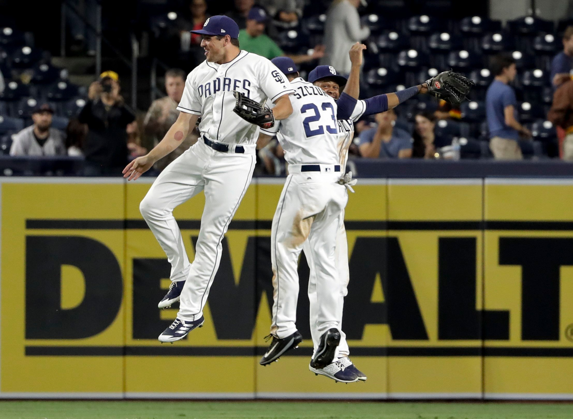 San Diego Padres outfielders Hunter Renfroe, left, Matt Szczur, center, and Manuel Margot celebrate after the Padres defeated the Atlanta Braves 6-0 in a baseball game Thursday, June 29, 2017, in San Diego. (AP Photo/Gregory Bull)