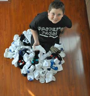 12-year-old Parker Ward pulled on a pair of socks to ease cold feet suddenly got to thinking about the homeless. (Photo: Parker's Pairs website)