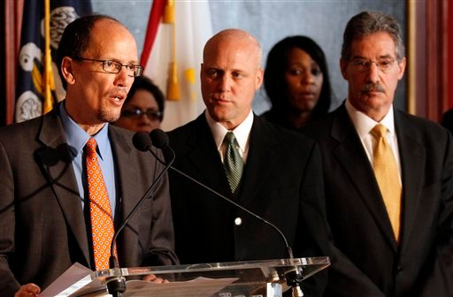 Assistant Attorney General Thomas Perez, left, speaks at a news conference in New Orleans, Thursday, March 17, 2011, to announce the findings of a U.S. Department of Justice report into the New Orleans Police Department.