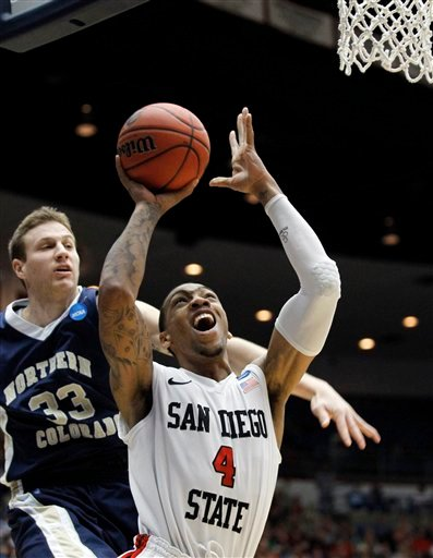 San Diego State's Malcolm Thomas (4) shoots as Northern Colorado's Neal Kingman looks on during a West Regional NCAA college basketball tournament second round game Thursday, March 17, 2011, in Tucson, Ariz.
