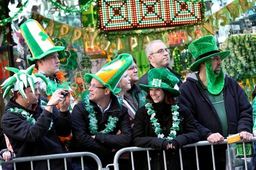 Visitors from Fribourg, Switzerland, watch as participants march up Fifth Avenue during New York's annual St. Patrick's Day parade, Thursday, March 17, 2011.
