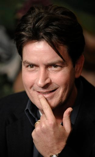 FILE - In this Jan. 28, 2009 file photo, actor Charlie Sheen is interviewed at an event to celebrate Planet Hollywood's purchase of Italian restaurant chain Buca di Beppo, at Universal CityWalk in Los Angeles.