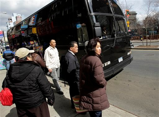 Passengers in Manhattan's Chinatown neighborhood in New York wait to board a bus to the Mohegan Sun casino Tuesday, March 15, 2011.