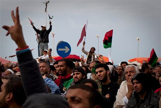 Libyan people celebrate in the main square of Benghazi, eastern Libya, Friday, March 18, 2011.