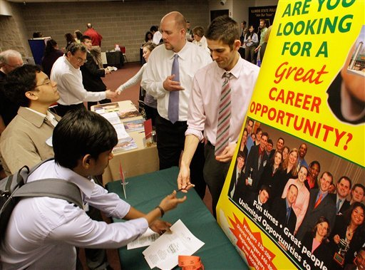 In this Feb. 17, 2011 photo, businesses solicit students as they fill out job applications during the Springfield Collegiate Career Job Fair at the University of Illinois Springfield, in Springfield, Ill.