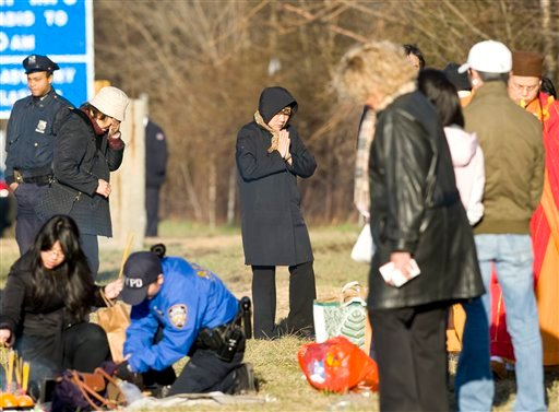 Victim's family members participate in a Buddhist service at the location of the tour bus crash, Saturday, March 19, 2011 in the Bronx borough of New York.