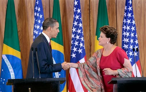 U.S. President Barack Obama, left, shakes hands with Brazilian President Dilma Vana Rousseff, right, during their joint news conference at the Palacio do Planalto in Brasilia, Brazil, Saturday, March 19, 2011.