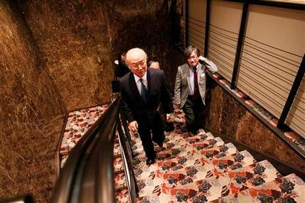 Yukiya Amano, director general of the International Atomic Energy Agency (IAEA), center, goes up the stairs to the venue of a press conference at the Japan National Press Club, Friday, March 18, 2011 in Tokyo, Japan. (AP Photo/Eugene Hoshiko)