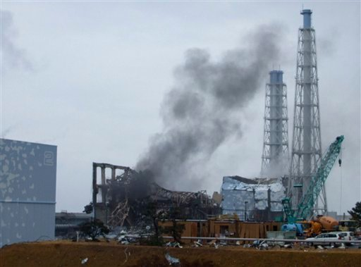 In this photo released by Tokyo Electric Power Co. (TEPCO), gray smoke rises from Unit 3 of the tsunami-stricken Fukushima Dai-ichi nuclear power plant in Okumamachi, Fukushima Prefecture, Japan March 21, 2011. (AP Photo/Tokyo Electric Power Co.)