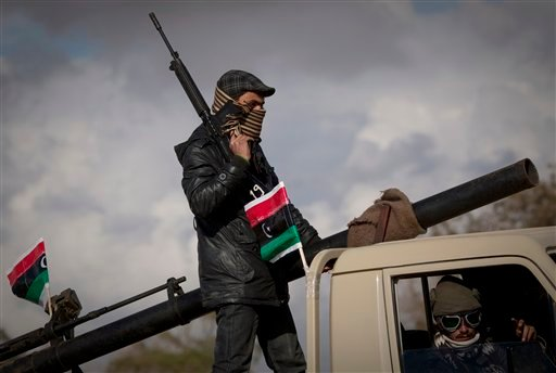 Libyan rebels patrol the center of Benghazi, eastern Libya, Sunday, March 20, 2011.