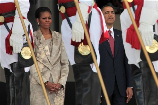 U.S. President Barack Obama, right, stands with his wife first lady Michelle Obama after arriving to Planalto palace in Brasilia, Brazil, Saturday March 19, 2011.