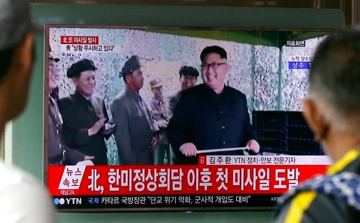 A TV news program shows a file image of North Korean leader Kim Jong Un, at Seoul Railway Station in Seoul, South Korea. in Seoul, South Korea, Tuesday, July 4, 2017. (AP Photo/Ahn Young-joon)