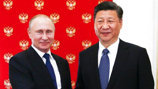Russian President Vladimir Putin, left, and China's President Xi Jinping.