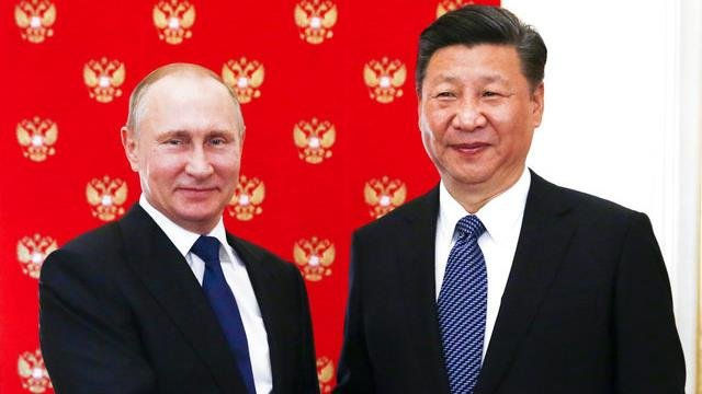 Russian President Vladimir Putin, left, and China's President Xi Jinping.