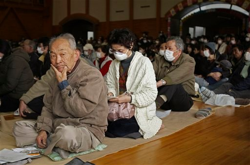 Residents on the outskirts of Fukushima crowd into an elementary school gymnasium for a town hall meeting on the impact of radiation exposure from the nearby leaking Fukushima nuclear facilities. (AP Photo/Wally Santana)