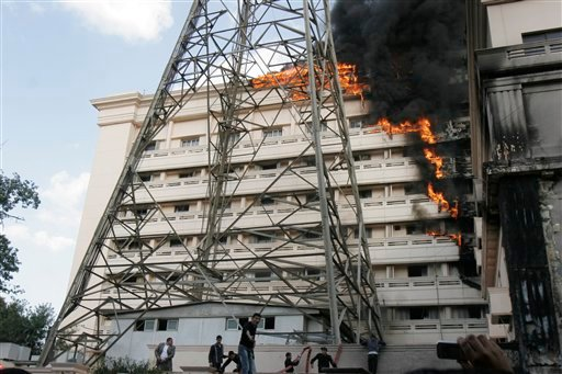 Flames engulfpart of the Interior Ministry complex in Cairo, Egypt, Tuesday, March 22, 2011. (AP Photo/Mohammed Abu Zaid)