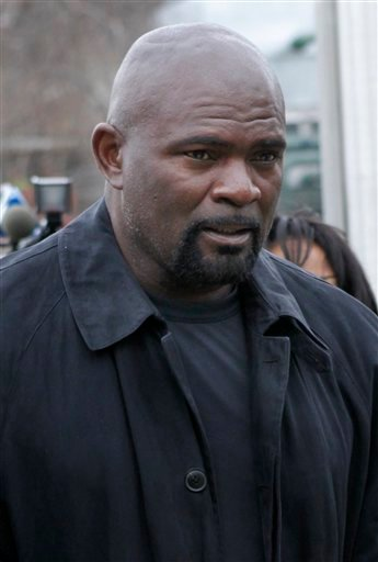 Former New York Giants football star Lawrence Taylor arrives at the Rockland County Courthouse for formal sentencing in New City, N.Y., Tuesday, March 22, 2011.
