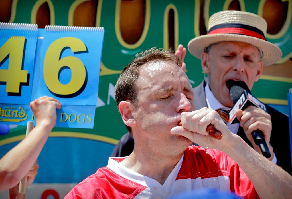 Joey Chestnut eats two hot dogs at a time during the Nathan's Annual Famous International Hot Dog Eating Contest Tuesday July 4, 2017, in New York.