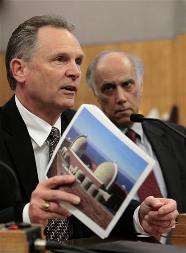 Steve David, director of site services at the Diablo Canyon Power Plant, displays a picture of the nuclear power plant, located near San Luis Obisop, as he discusses the plant's safety in case of an earthquake.
