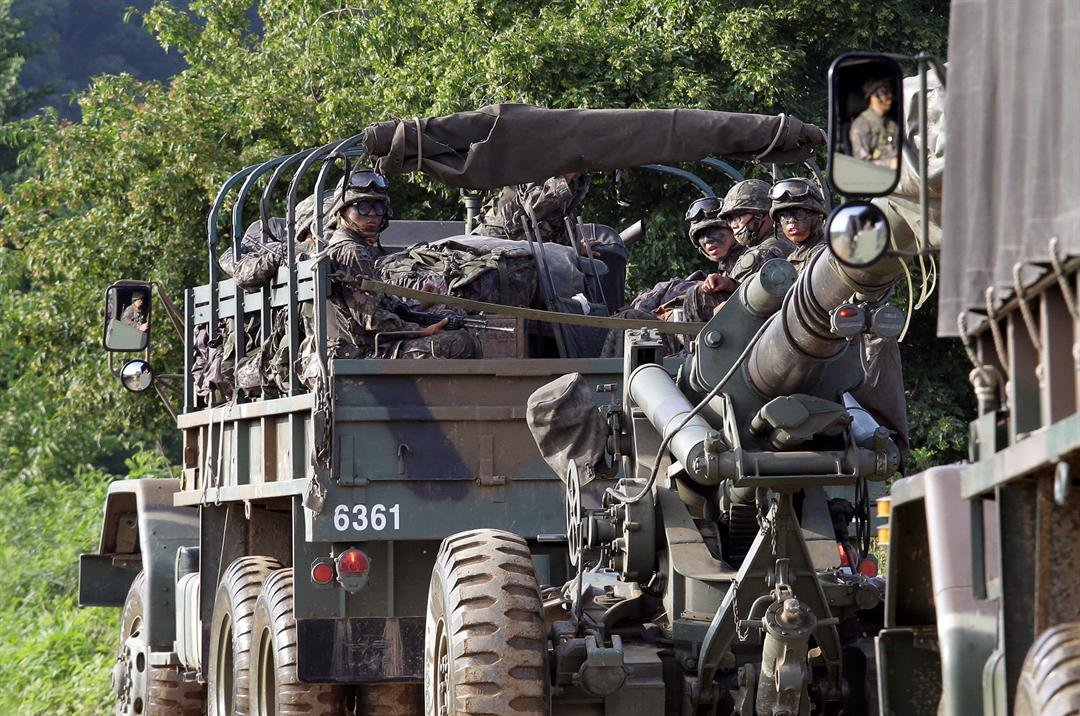 South Korean army soldiers ride on the back of a truck during an annual exercise in Paju, near the border with North Korea, South Korea, Tuesday, July 4, 2017.  (AP Photo/Ahn Young-joon)