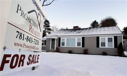 FILE - In this file photo taken Jan. 10, 2011, a for sale sign hangs in front of a home, in Millis, Mass.New home? Or existing one? For buyers, the decision is getting easier.