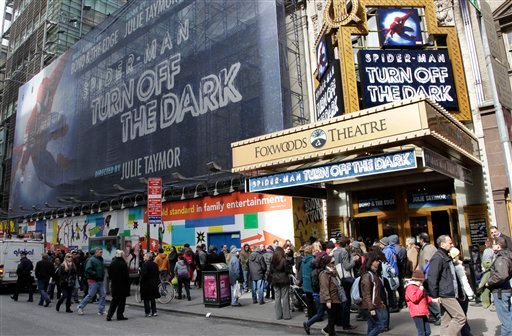 "FILE - In this March 9, 2011 file photo, people line up to enter the Foxwoods Theatre for a matinee showing of ""Spider-Man: Turn Off the Dark,"" in New York."