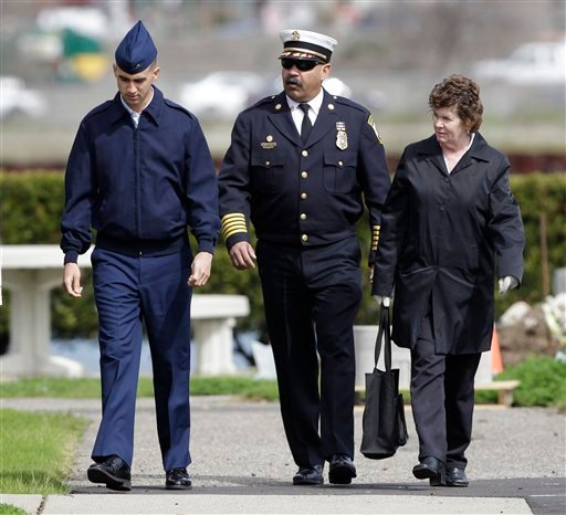 Coast Guard Petty officer Paul Ramos, left, and his parents Patricia, right, and Alfredo Ramos, center, arrive at a Coast Guard court martial in Alameda, Calif., Monday, March 7, 2011.
