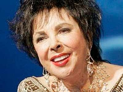 FILE- In this Sept. 27, 2007 file photo, actress Elizabeth Taylor is shown at the Macy's Passport 2007 charity benefit in Santa Monica, Calif.