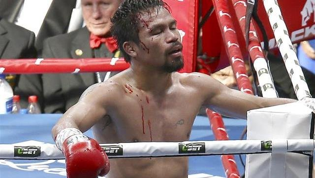 Manny Pacquiao of the Philippines reacts after his loss to Jeff Horn of Australia.