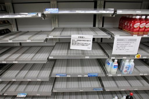 Shelves selling bottled water are empty at a convenience store in Tokyo Wednesday, March 23, 2011. (AP Photo/Lee Jin-man)