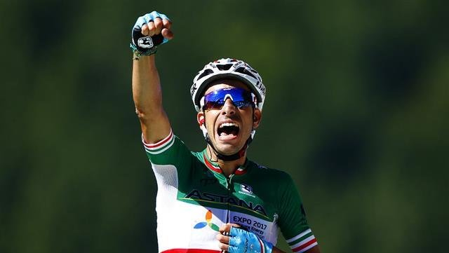 Italy's Fabio Aru celebrates as he crosses the finish line to win the fifth stage of the Tour de France cycling race over 160.5 kilometers (99.7 miles) with start in Vittel and finish in La Planche des Belles Filles, France, Wednesday, July 5, 2017. (AP P