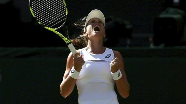 Britain's Johanna Konta celebrates after winning the Women's Singles Match against Croatia's Donna Vekic on day three at the Wimbledon Tennis Championships in London Wednesday, July 5, 2017.