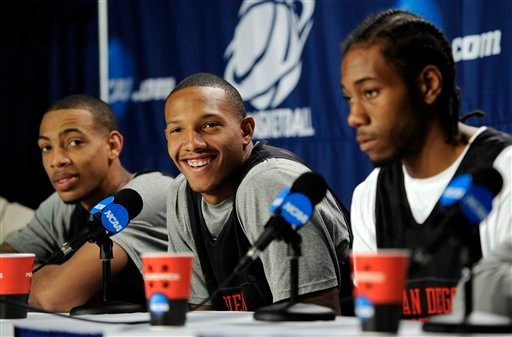 San Diego State's Billy White, center, laughs as teammates Malcolm Thomas, left, and Kawhi Leonard look on during a news conference for a West regional semifinal game in the NCAA college basketball tournament, Wednesday, March 23, 2011, in Anaheim, Calif.