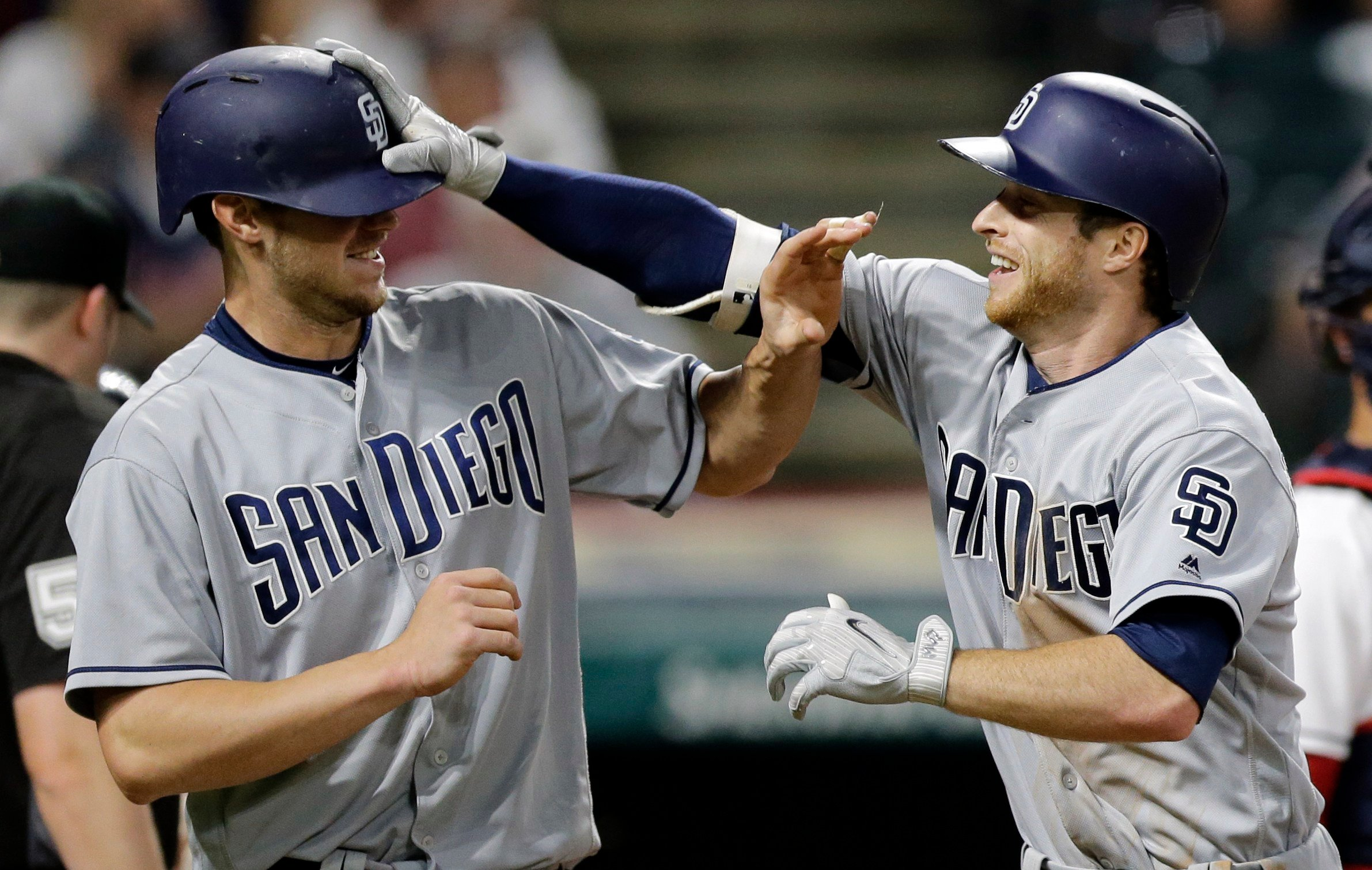 San Diego Padres' Cory Spangenberg, right, grabs Wil Myers's helmet after Spangenberg hit a two-run home run. Myers scored on the play. (AP Photo/Tony Dejak)