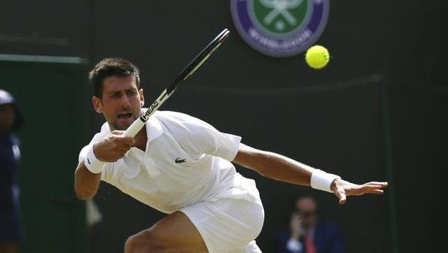 Serbia's Novak Djokovic returns the ball to Czech Republic's Adam Pavlasek during their Men's Singles Match on day four at the Wimbledon Tennis Championships in London Thursday, July 6, 2017.