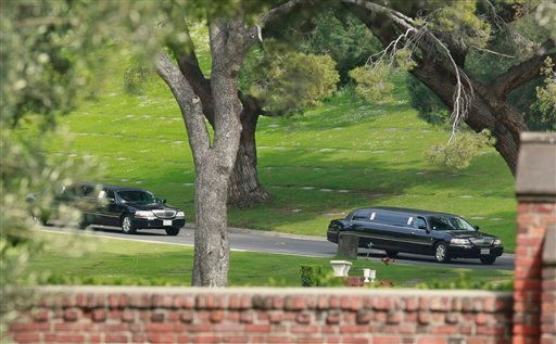 Stretch limousines leave Forest Lawn Cemetery after funeral services for Elizabeth Taylor Thursday March 24, 2011 in Glendale, Calif. Taylor, 79, died early Wednesday of congestive heart failure while surrounded by her four children at Los Angeles' Cedars