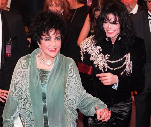 FILE - This Feb. 16, 1997 file photo shows Elizabeth Taylor arriving with Michael Jackson at the Pantages Theater in Los Angeles for her birthday celebration.