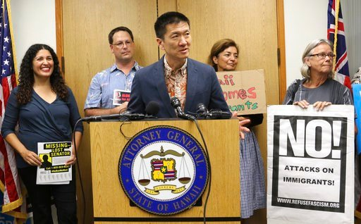 Hawaii Attorney General Douglas Chin speaks at a news conference about President Donald Donald Trump's travel ban, Friday, June 30, 2017 in Honolulu. (AP Photo/Caleb Jones)