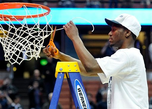 Connecticut's Kemba Walker cuts the net off the basket after the NCAA West regional college basketball championship game, Saturday, March 26, 2011, in Anaheim, Calif. Connecticut beat Arizona 65-63. (AP Photo/Mark J. Terrill)