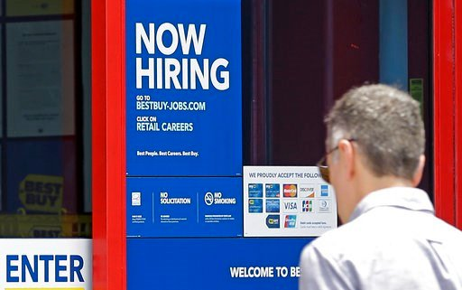 "(AP Photo/Alan Diaz) In this Monday, May 22, 2017, photo, a ""Now Hiring"" sign welcomes a customer entering a Best Buy store in Hialeah, Fla."