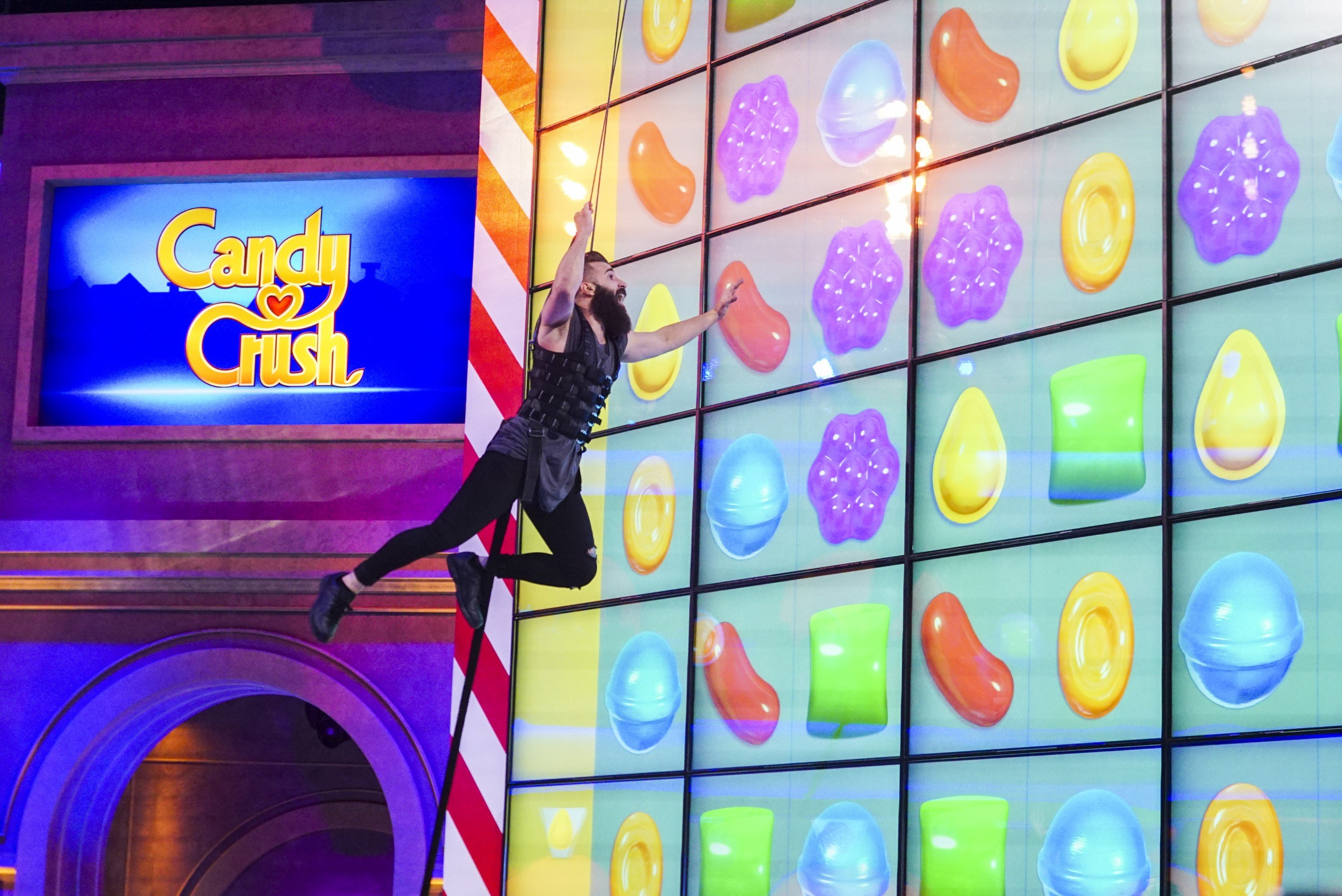 """This image released by CBS shows Paul Abrahamian, a contestant on """"Big Brother 18"""" and competing in the new game show, """"Candy Crush,"""" premiering, Sunday, July 9 at 9 p.m. ET on CBS. (Sonja Flemming/CBS via AP)"""