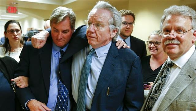 Shannon Kepler celebrates with his attorney, Richard O'Carroll, after a hung jury verdict was announced at the Tulsa Country Courthouse, Friday, July 7, 2017, in Tulsa, Okla. A third mistrial was declared Friday in the murder case of Kepler, a white forme