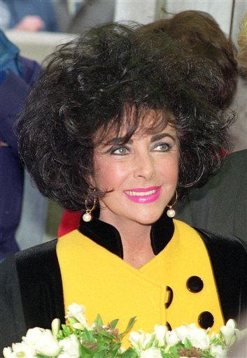 FILE - In this Nov. 5, 1991 file photo, Elizabeth Taylor is shown in London. Over 60 unpublished love letters of the late actress will be put up for auction in New Hampshire.