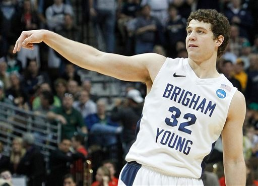 BYU guard Jimmer Fredette (32) reacts after scoring against Wofford during the second half of a Southeast regional second round NCAA tournament college basketball game. (AP)