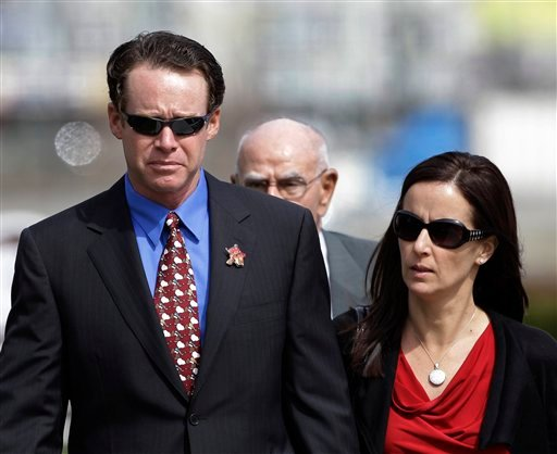 Caroline and Alan DeWeese, parents of Anthony DeWeese, walk to a Coast Guard court martial in Alameda, Calif., Monday, March 7, 2011.